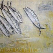 FRESH FISH LAYING ON YELLOW PRESS